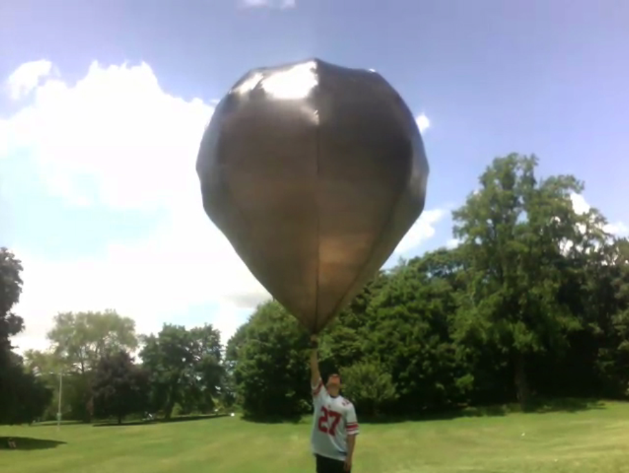 Jake holding a 10' sphere solar balloon